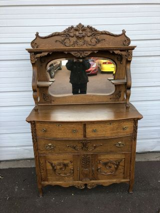 Antique Victorian Oak Sideboard / Buffet With Ornate Carvings With Face