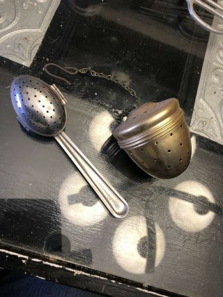 Two Vintage Tea Strainers One Spoon Hinged And One Acorn Shaped Screw On Top